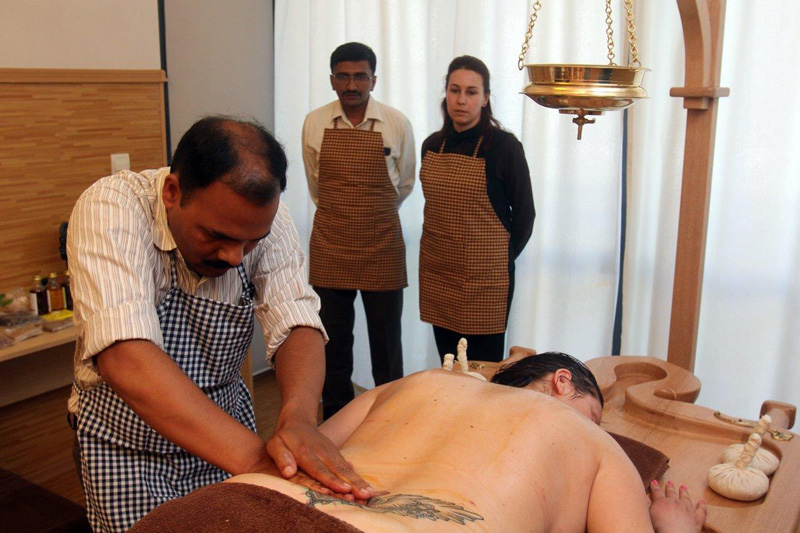 Ayurveda treatment in the back and waist